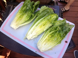 """the """"oiled"""" lettuce waiting to go on the grill."""